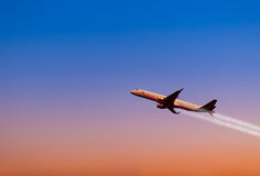 A plane flying in a beautiful sunset Stock Photos