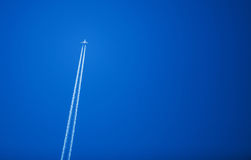 Plane Flying In Blue Sky Background Stock Photo