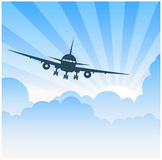 Plane flying in clouds Royalty Free Stock Photo