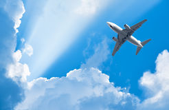 Plane is flying among clouds Royalty Free Stock Image