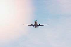 Plane flying through clouds in the sky. Jet aircraft. Royalty Free Stock Photo