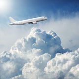 Plane flying through dramatic storm clouds Royalty Free Stock Photography