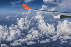 Plane flying high above the clouds. In troposphere Royalty Free Stock Photography