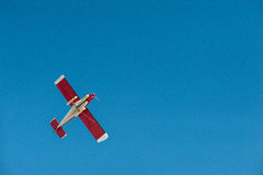 Plane 1. Flying light aircraft on blue sky background royalty free stock photography