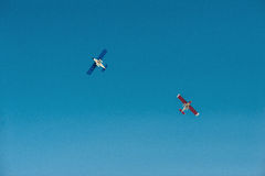 Plane 2. Flying light aircraft on blue sky background stock photography