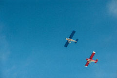 Plane 3. Flying light aircraft on blue sky background royalty free stock images