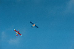 Plane 4. Flying light aircraft on blue sky background royalty free stock photos