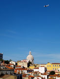Plane flying Lisbon. Passenger plane over the city Lisbon (Portugal Europe stock photography