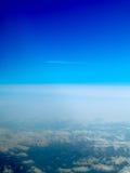 Plane flying over Alps Stock Photo