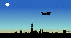 Plane flying over the city. Vector Stock Photos