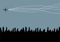Plane flying over the city. Background Stock Images
