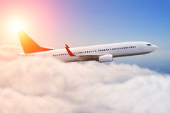 Planeflying over the clouds Royalty Free Stock Image