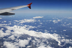 The plane is flying over the Dolomites Stock Photo
