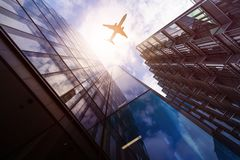 Plane over highrise buildings Royalty Free Stock Photography