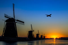 Plane flying over Kinderdijk Stock Images