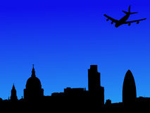 Plane flying over London Royalty Free Stock Images