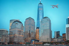 Plane flying over Manhattan. Financial district Stock Photos