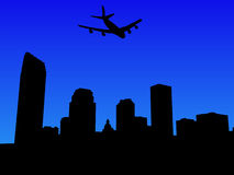 Plane flying over New Orleans Stock Images