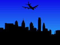 Plane flying over Philadelphia Stock Photos