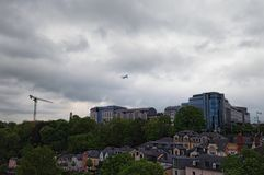 The plane is flying over the residential area of Luxembourg, Grand Duchy of Luxembourg. Cloudy spring morning in Luxembourg City. Downtown city, scenic view to royalty free stock photos