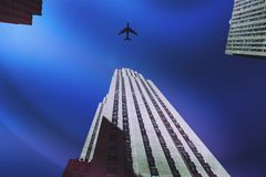 Plane Flying Over A Skyscraper Royalty Free Stock Image