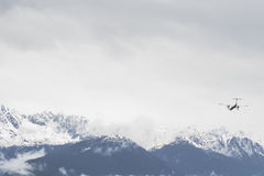 Plane flying over Snowy mountains. In the Alps near Innsbruck Royalty Free Stock Images