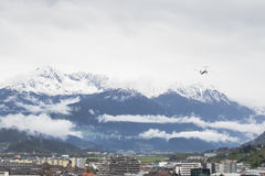Plane flying over Snowy mountains in Insbruck. Plane flying over Snowy mountains in the Alps near Innsbruck Stock Photos