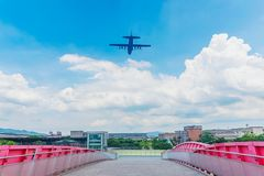 Plane flying over Taipei expo park. TAIPEI, TAIWAN - JULY 03: This is a typical view of a plane flying over Taipei expo park into Songshan airport on July 03 Stock Photo