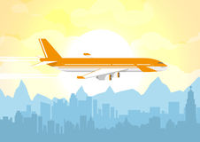Plane flying over urban city Royalty Free Stock Photos