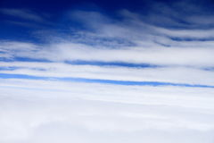 The plane is  flying passing high clouds Royalty Free Stock Photo