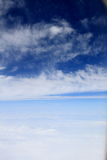 The plane is  flying passing high clouds Stock Image