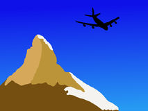Plane flying past Matterhorn Royalty Free Stock Image