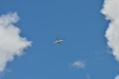 Plane flying on the sky Stock Photos