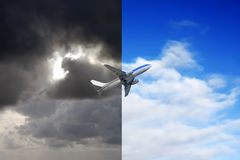 Plane flying from stormy sky into blue sky Royalty Free Stock Photo