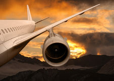 Plane is flying at sunset Royalty Free Stock Photo
