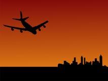 Plane flying to Atlanta. Four engine plane flying towards Atlanta at dusk Royalty Free Stock Images