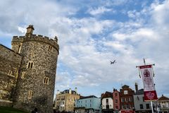 Plane flying into the town of Windsor Royalty Free Stock Photography