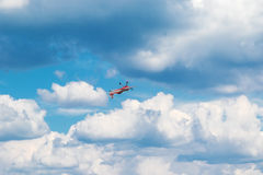 Plane flying upside down Stock Photography