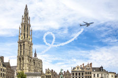 A plane flys always form the city anvers, belgium Stock Photo