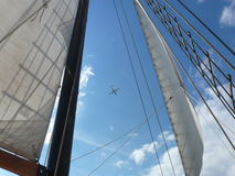 Plane Framed by Sails and Rigging Royalty Free Stock Image
