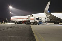 Plane fuel service. Refueling a plane at night Royalty Free Stock Image