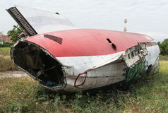 Plane fuselage wreckage sitting on the ground Stock Images