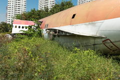 Plane fuselage wreckage sitting on the ground Royalty Free Stock Photos