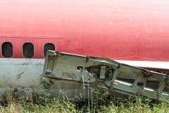Plane fuselage wreckage sitting on the ground Stock Photos