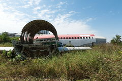 Plane fuselage wreckage sitting on the ground Royalty Free Stock Images