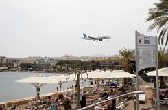Plane goes on landing above beach in Eilat, Israel Royalty Free Stock Image