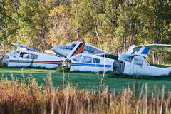 Plane Graveyard. A plane graveyard in the country, showing many pieces of old prop planes in a field Royalty Free Stock Images