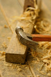 Plane and hammer. Picture of a plane and a hammer in a working palce Stock Photography