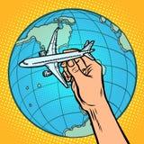 Plane in hand. metaphor of flight to the Western hemisphere. Comic cartoon pop art vector retro vintage drawing vector illustration