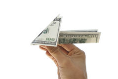 Plane of hundred dollar bills. Hundred-dollar airplane in hand men Stock Images